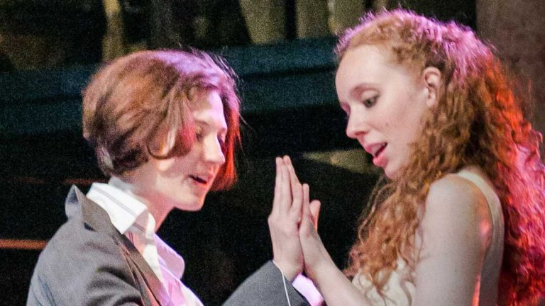 Rachel Gluck (left) as Romeo and Isa St. Clair as Juliet in Curio Theatre Company's