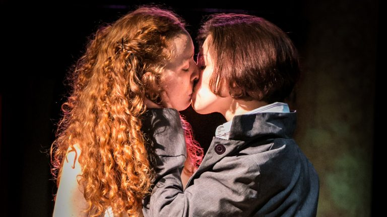 Isa St. Clair (left) as Juliet and Rachel Gluck as Romeo in Curio Theatre Company's