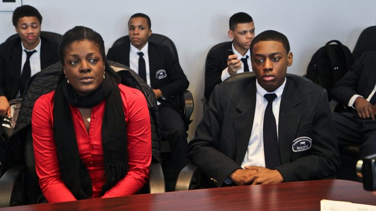 Police arrested Darrin Manning, 16, (right) while on his way to a school basketball game January 7, 2014. Manning's mother, Ikea Coney (left) and others are asking DA Seth Williams to drop the charges. (Kimberly Paynter/WHYY)