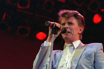 David Bowie is shown performing Wembley Stadium in London in 1985. (AP Photo/Joe Schaber)