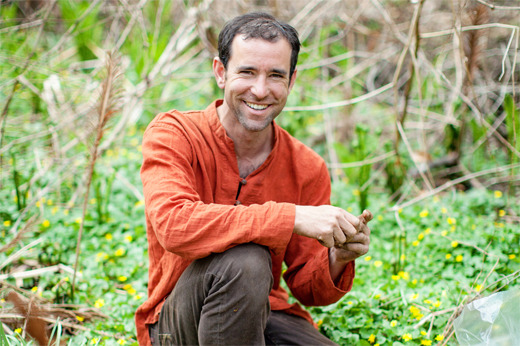 Urban forager David Siller prospects for springtime edibles on the Reading Viaduct. (photo courtesy Fair Food)