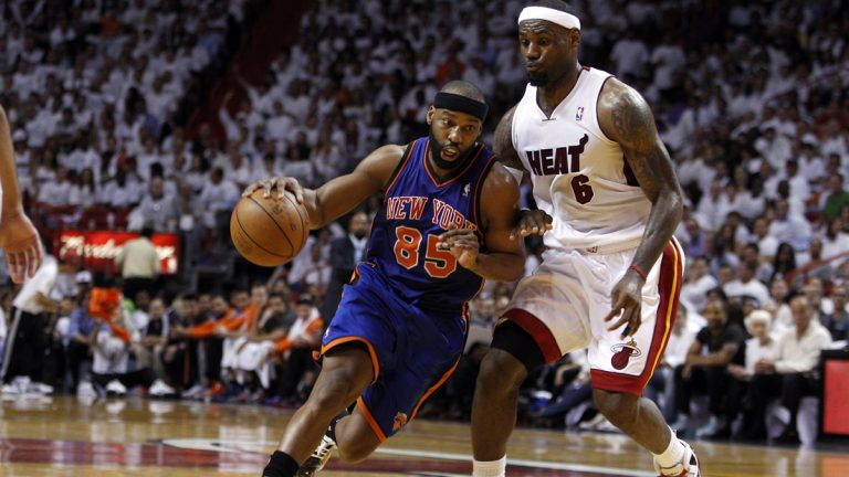 New York Knicks' Baron Davis (85) drives to the basket past LeBron James (6) in the second half during an NBA basketball game in the first round of the Eastern Conference playoffs in Miami