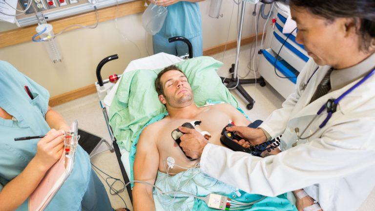 Doctors attempt to restart a patient's heart. Unfortunately