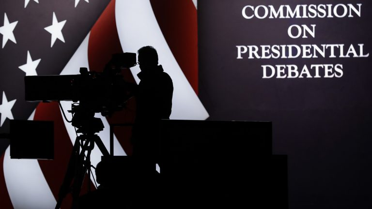 A television camera operator tests his position during a rehearsal for the third presidential debate between Republican presidential nominee Donald Trump and Democratic presidential nominee Hillary Clinton at UNLV in Las Vegas