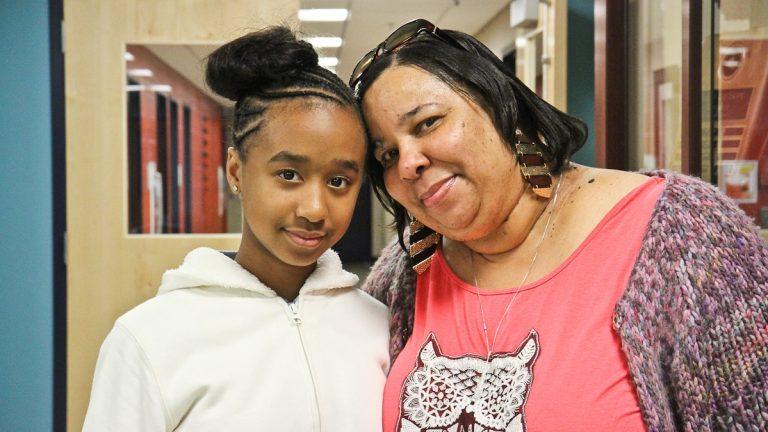 Alyse Nichols helps her grandmother