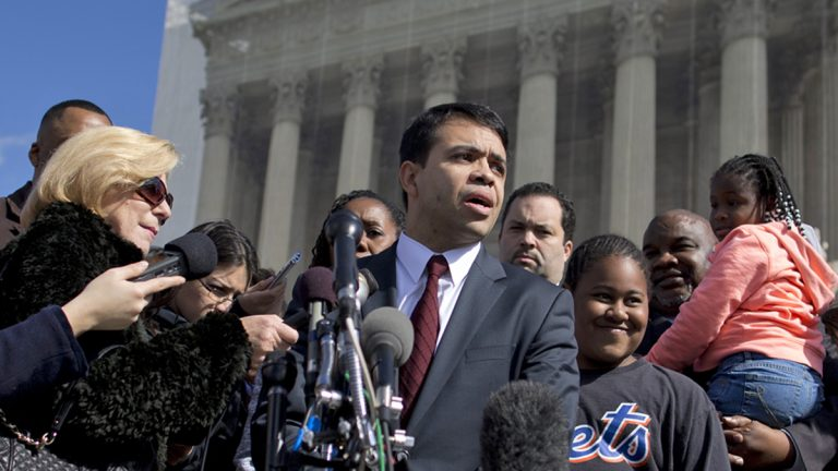 Debo Adegbile (center), special counsel, NAACP Legal Defense Fund, speaks with reporters outside the Supreme Court in Washington. (AP file photo/Evan Vucci)