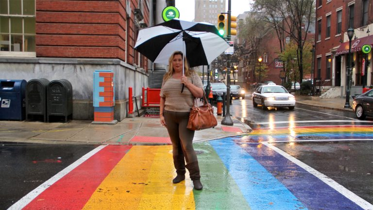 Deja Lynn Alvarez stands at the intersection of 13th and Locust streets
