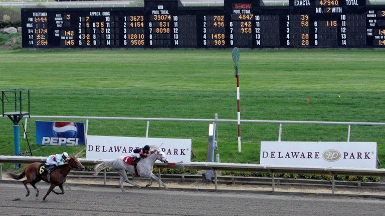 Horses cross the finish line at Delaware Park in Stanton, Del. (AP Photo/Rob Carr)