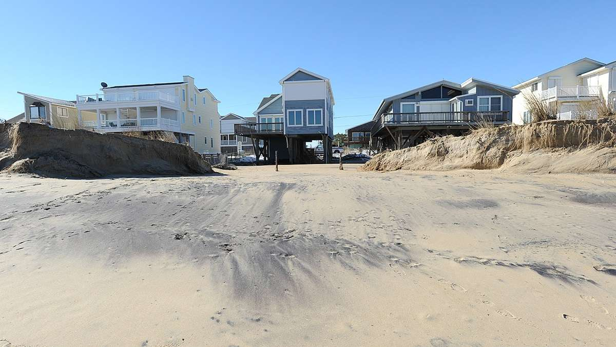 High winds and water broke through this dune and caused other damage at the Delaware beaches on  January 22-24.(Chuck Snyder/for NewsWorks)