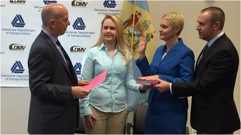 Former Del. DMV Director Jennifer Cohan was sworn in as state's 10th secretary of transportation by Gov.Jack Markell. Cohan's husband Chris and daughter Brittany join her.(Paul Parmelee/WHYY)