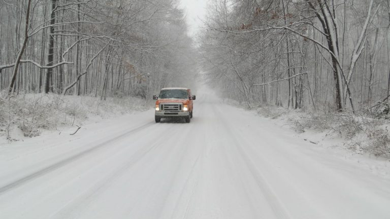 A snowy road outside DelDOT facilities in Newark. (Avi Wolfman-Arent, Newsworks)