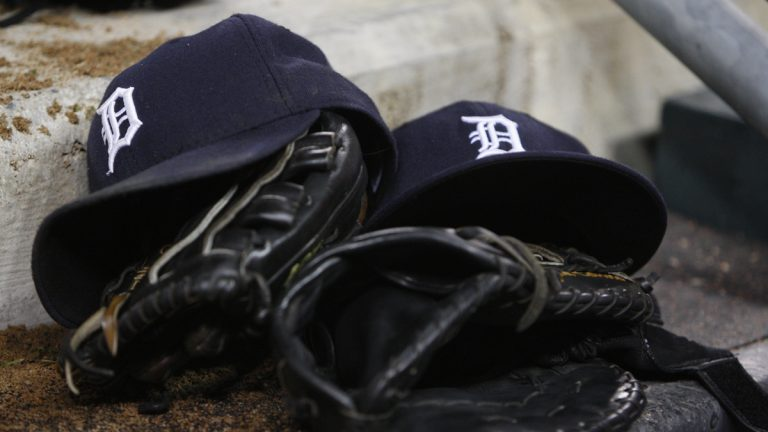 Detroit Tigers caps and gloves (AP Photo/Carlos Osorio, file)