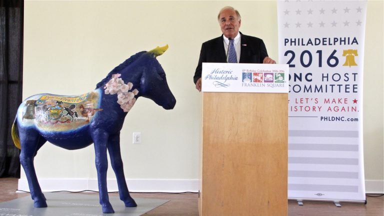 Democratic National Convention Chairman Ed Rendell presents one of 57 decorated fiberglass donkeys that will be placed around the city during the convention. (Emma Lee/WHYY)