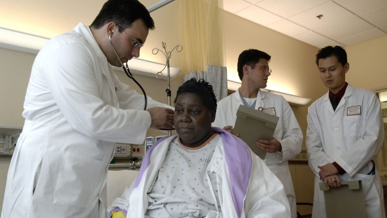 A physician performs a standard physical exam on a patient. (Credit: National Cancer Institute)