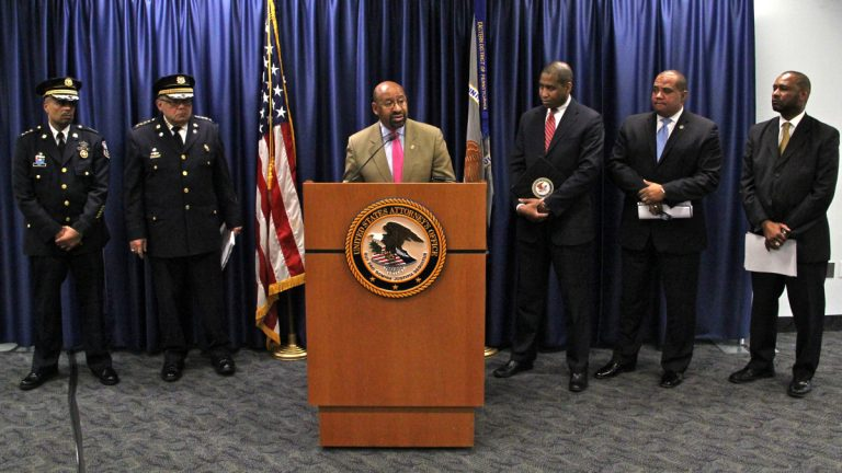 Mayor Michael Nutter responds to a Justice Department assessment of the Philadelphia Police department use of force. With him are Deputy Commissioner Richard Ross, Commissioner Charles Ramsey, U.S. Attorney Zane Memeger, Ronald Davis, director of the Office of Community Oriented Policing Services, and former Madison Police Chief Noble Wray. (Emma Lee/WHYY)