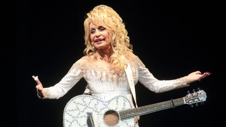 """Dolly Parton performs in concert during her """"Pure & Simple Tour"""" at The Mann Center for the Performing Arts on Wednesday"""