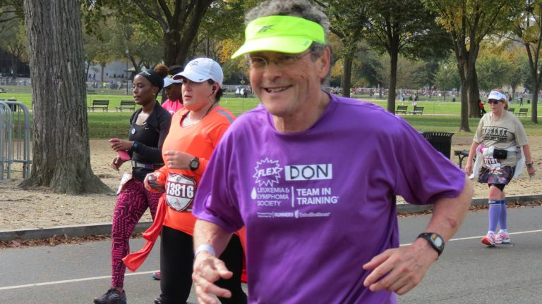 Don Wright is shown running the 2015 Marine Corps Marathon in Crystal City