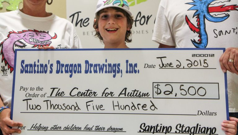 Santino 'The Dragon Master' Stagliano presented a check for $2,500 to The Center for Autism on Tuesday afternoon. (Kimberly Paynter/WHYY)