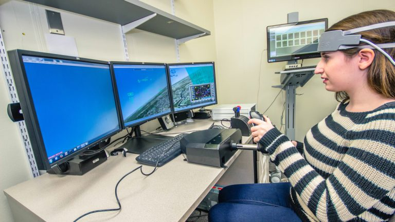 Drexel University researchers are using functional near-infrared measurements of brain activity to evaluate how well pilots and air traffic controllers perform. (Patrick Craven/Drexel University)