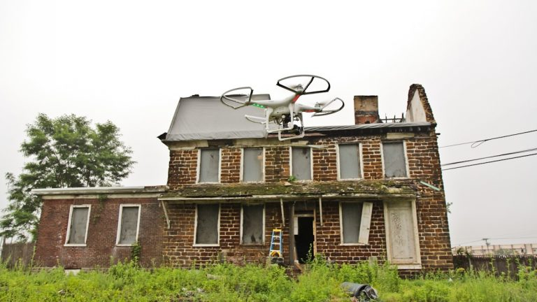 Historic Preservation Architects use drones equipped with cameras to safely view the damaged and hard to reach places of buildings during assessment. (Kimberly Paynter/WHYY)