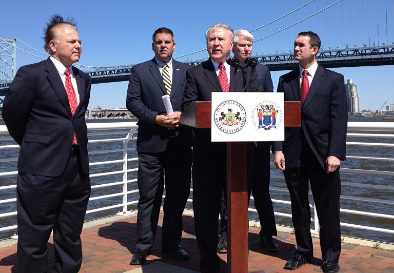 Pennsylvania State Sen. John Rafferty (at podium) and other officials call for permanent reforms at the Delaware River Port Authority. (Dave Davies/WHYY)