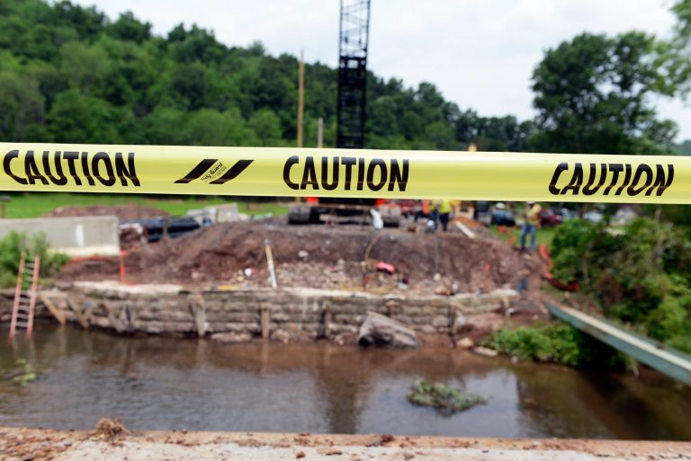 Caution tape marks the verge of a bridge replacement in Curtin Township in Centre County on Route 1002. (Kelly Tunney/WPSU)
