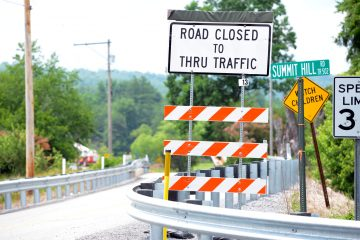 Pennsylvania Infrastructure Report Card: A sign warns traffic about a bridge under construction about a mile ahead; access to the area will be limited again when another bridge a few miles later is slated to be replaced next year. (Kelly Tunney/For WPSU)