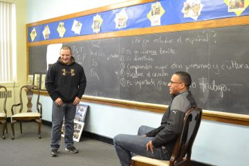 Two of the Hazleton Police Department's newest hires practice interacting in Spanish. Officer Pedro Bautista (right) is bilingual but attends class to help his fellow officers learn.  (Eleanor Klibanoff/WPSU)