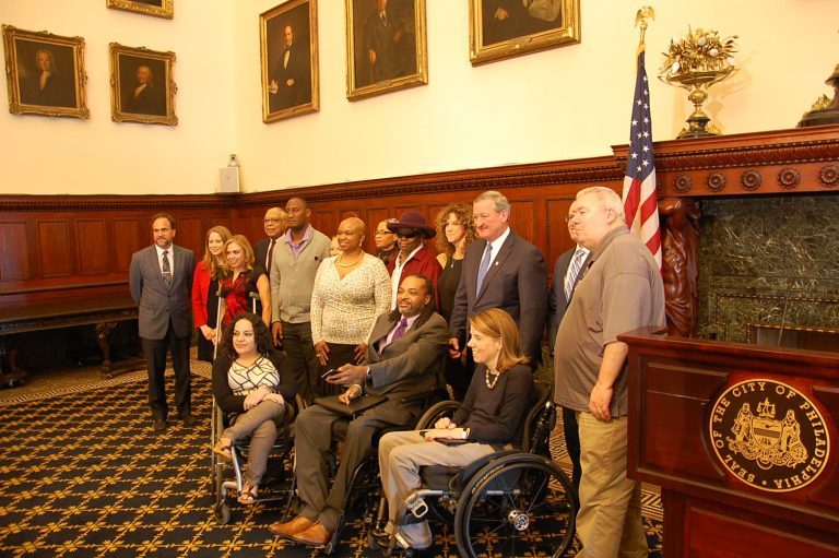 Mayor Jim Kenney and the Mayor's Commission on People with Disabilities gather at City Hall. (Tom MacDonald/WHYY)