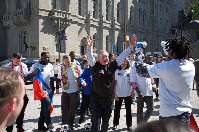 Mayor Jim Kenney celebrates scoring a goal with Unity Cup player. (Tom MacDonald/WHYY)