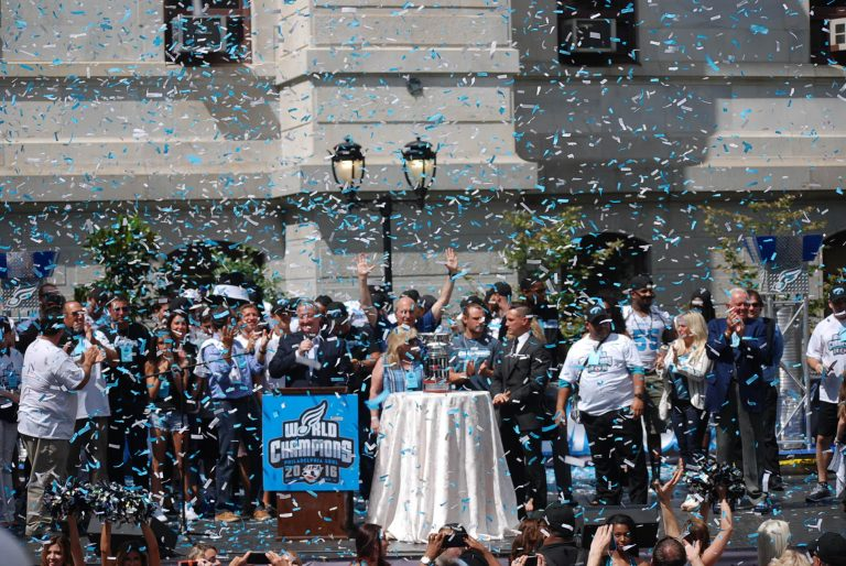 Confetti flies as the Soul players and supporters celebrate the arena football team's championship win. (Tom MacDonald/WHYY)
