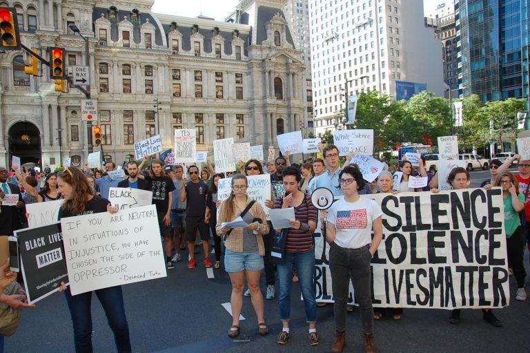 Protestors block streets outside City Hall (Tom MacDonald / WHYY)