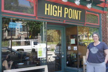Meg Hagele stands in front of High Point Cafe on Carpenter Lane. (Greta Iverson/for NewsWorks)