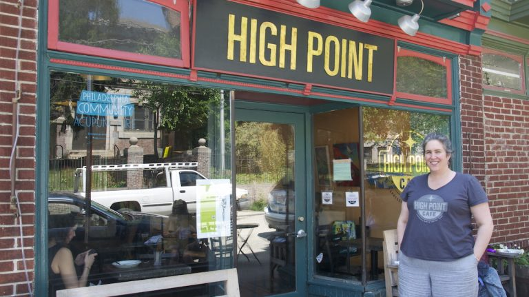 Meg Hagele stands in front of High Point Cafe on Carpenter Lane. (Greta Iverson/for NewsWorks)