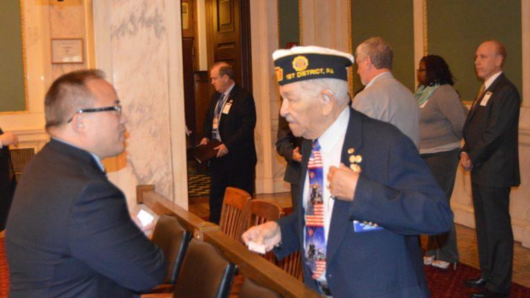 Philadelphia City Councilman David Oh talks with a veteran Monday. (Tom MacDonald/WHYY)