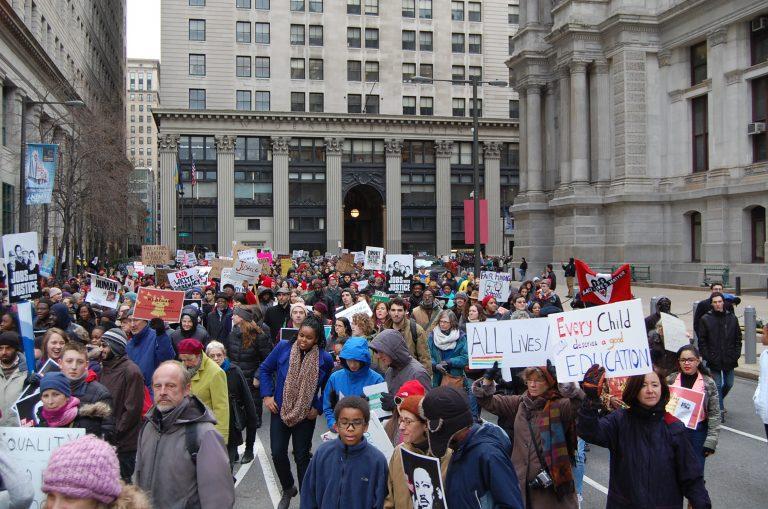 Protesters rounding Philadelphia City Hall before heading up Market Street (Tom MacDonald/WHYY)