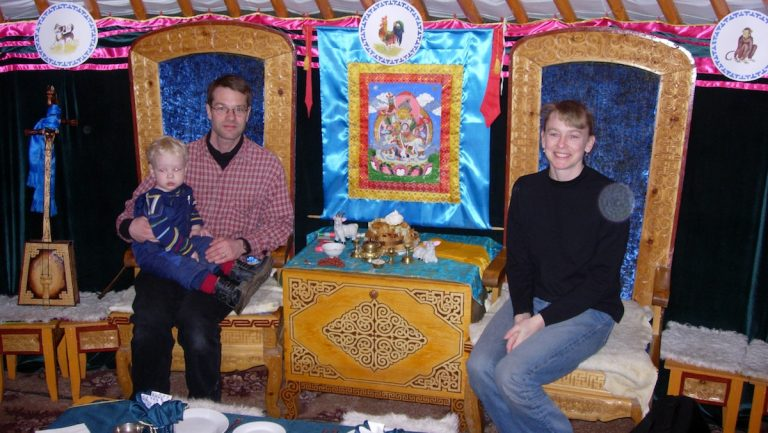 Melissa Chakars (left) with her husband, Janis, and their son Vilnis in a traditional Buryat hut. (Courtesy of Robert Quijada)