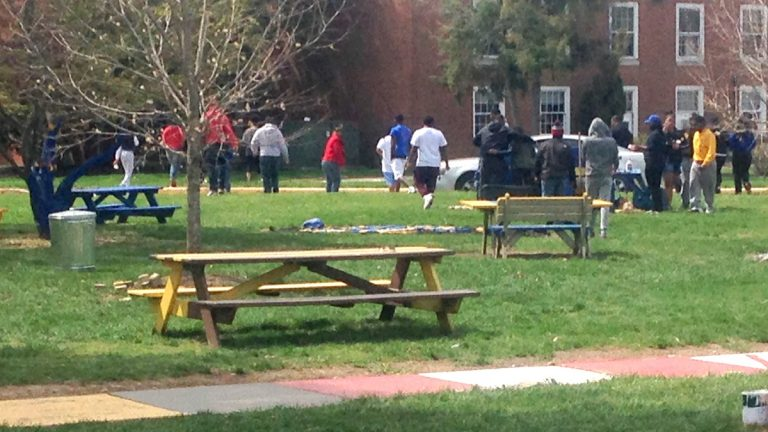 Students at Delaware State University disperse Sunday morning, April 19, 2015, after cleaning up the area where three people were shot and injured Saturday during a university-sanctioned cookout on campus in Dover, Del. Authorities are searching for the shooter. DSU President Harry L. Williams said students were told to stay inside their dormitories. Non-students were asked to leave campus. A second shooting occurred early Sunday at an apartment complex just off campus, but no one was injured. (AP Photo/Randall Chase)