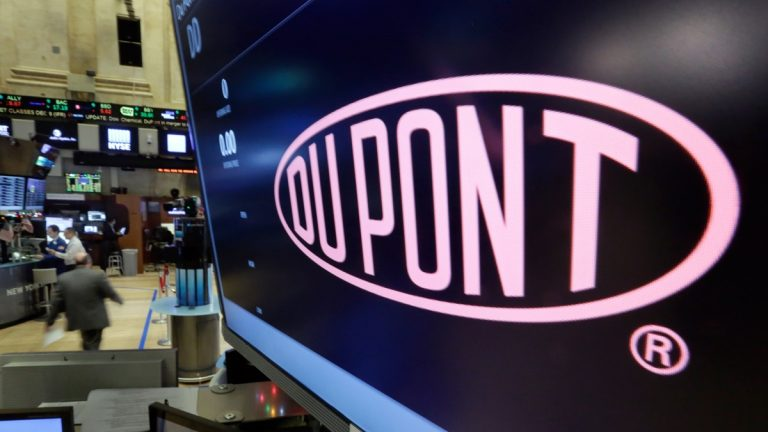 The company name of DuPont appears above its trading post on the floor of the New York Stock Exchange. (AP Photo/Richard Drew)