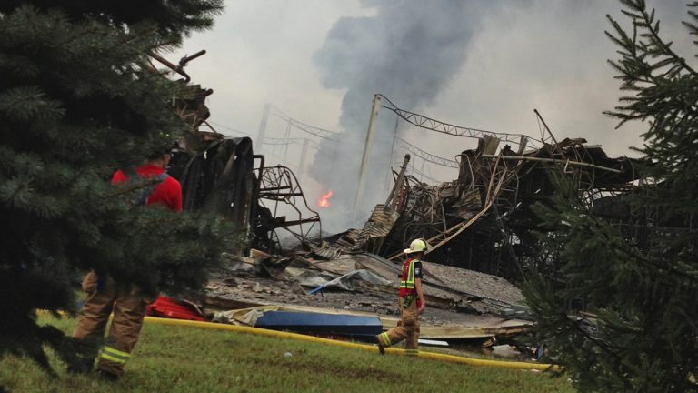 Firefighters continue to fight the blaze at the Dietz & Watson cold storage facility in Delanco, New Jersey.  (Zack Seward/WHYY)