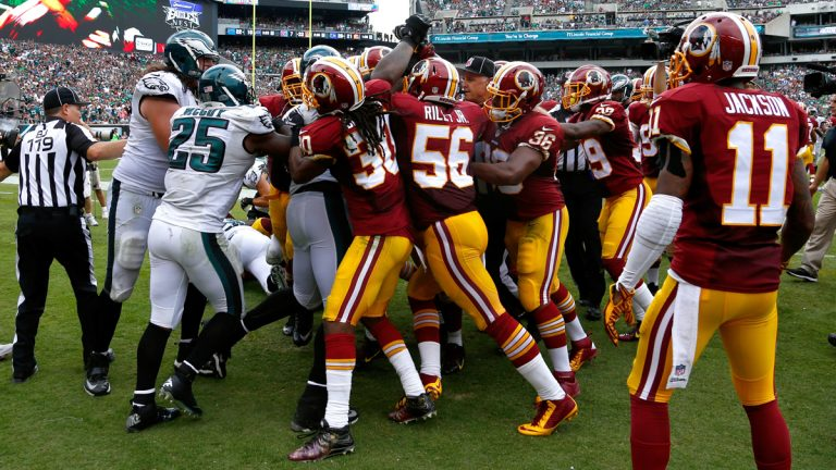 Officials try to break up a scuffle between the Washington and Philadelphia players during the second half of an NFL football game, Sunday, Sept. 21, 2014, in Philadelphia. (AP Photo/Matt Rourke)