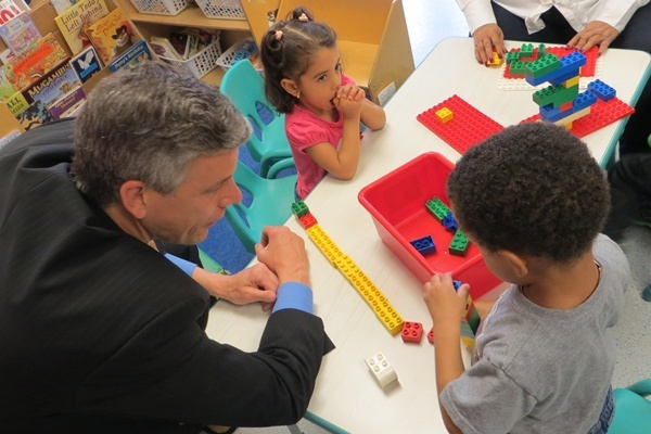 U.S. Education Sec. Arne Duncan visited with Delaware pre-school students last April. (Shana O'Malley/WHYY)