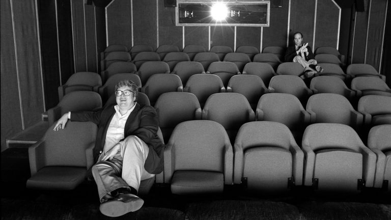 This June 13, 1984 photo released by Magnolia Pictures shows film critics Roger Ebert, left, and Gene Siskel in screening room for photo shoot in Chicago, used in the documentary