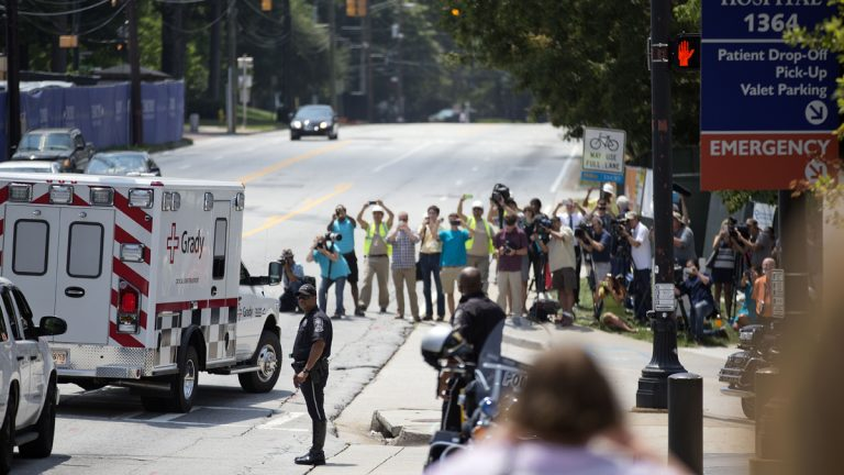 An ambulance transporting Nancy Writebol, an American missionary stricken with Ebola, is shown arriving at Emory University Hospital, Tuesday, Aug. 5, 2014, in Atlanta. (AP Photo/David Goldman)