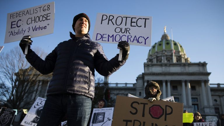 Protesters demonstrate ahead of Pennsylvania's 58th Electoral College at the Capitol in Harrisburg