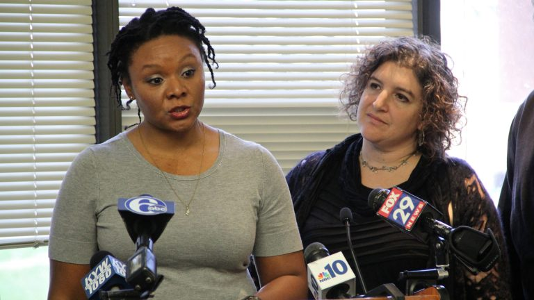 Robin Roberts (left), accompanied by Amy Laura Cahn of the Public Interest Law Center,  talks about deficiencies in Philadelphia public schools that led her to file complaints. (Emma Lee/WHYY)