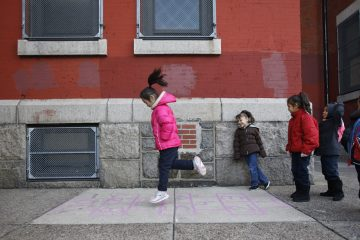 Students play hopscotch outside of Isaac A. Sheppard Elementary, a K-4 neighborhood school in Philadelphia, Pa.  (Photograph by Jessica Kourkounis)