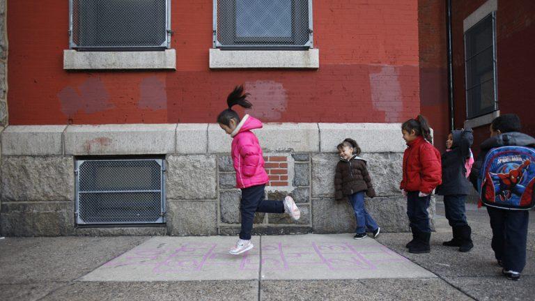 Students play hopscotch outside of Isaac A. Sheppard Elementary, a K-4 neighborhood school in Philadelphia, Pa.  (Photograph by Jessica Kourkounis)
