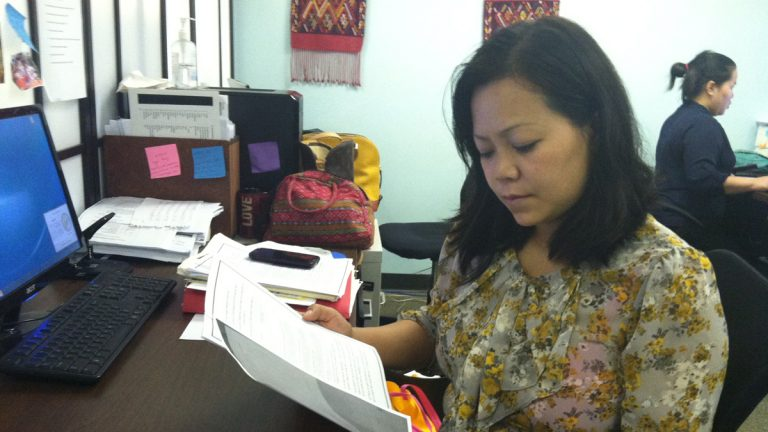 SEAMAAC outreach worker Zing Thluai has been helping people who receive notices submit requested immigration documents. She says some are confused, as they'd already submitted documents and are unsure whether their application is cleared. (Elana Gordon/WHYY)
