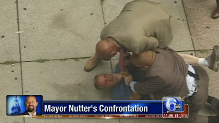 A young amateur photographer captured a confrontation between a homeless man and Philadelphia Mayor Michael Nutter's security detail in Center City. (Image via ABC6/WPVI-TV)